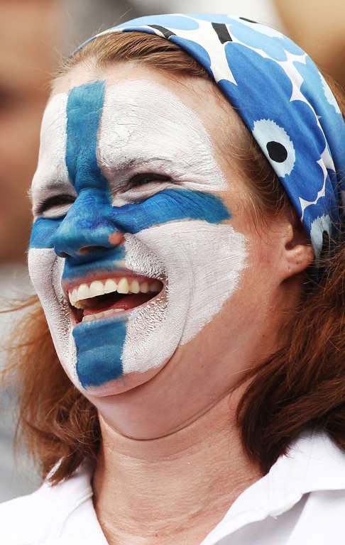 SYDNEY, AUSTRALIA - JANUARY 15:  A fan face painted with a Finnish flag smiles during day eight of the 2012 Sydney International at Sydney Olympic Park Tennis Centre on January 15, 2012 in Sydney, Australia.  (Photo by