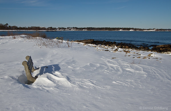 a very cold seat, a bench for relaxing, viewing the ocean, embedded in snow