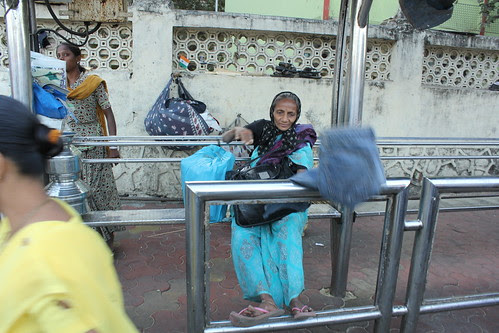 The Old Lady Was Selling Second Hand Jeans At The Bus Stop Mahim by firoze shakir photographerno1