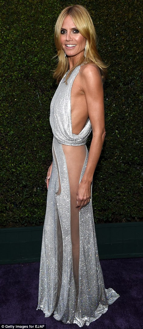 Model and mother-of-four Heidi Klum couldn't wear underwear with this revealing dress at Elton John's Oscar after party
