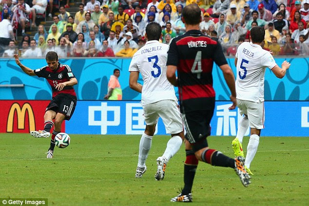 Only goal: Thomas Muller's strike meant defeat for the United States but they qualified nonetheless