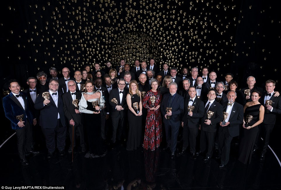 Night full of stars: The triumphant winners of the 71st British Academy Film Awards posed with their prizes at the end of the evening