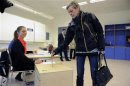 A woman casts her vote during Iceland's general elections in Reykjavik