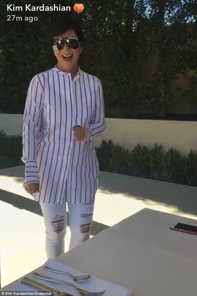 Matriarch with the most:Kris Jenner appeared in an quirky outfit involving a striped shirt and ripped denim