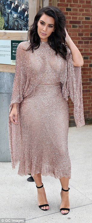 All that glitters: Kim sparkled from head to toe in the showstopping gown that she teamed with black ankle strap heels