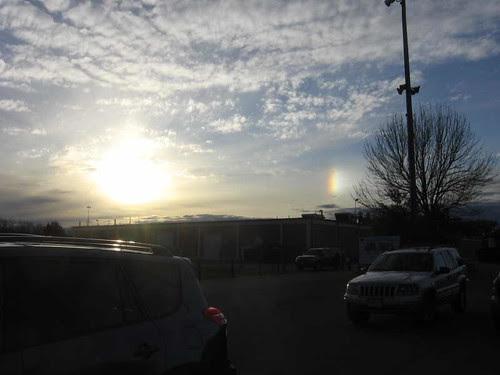 Setting sun, altocumulus clouds, and sundog