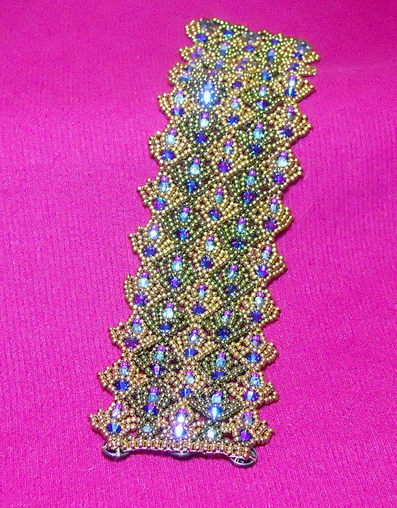 A pdf tutorial for a beautiful beaded lace bracelet cuff that features lots of sparkling Swarovski crystals and a hidden snaps clasp! When worn the snaps cannot be seen, and the bracelet appears as a seamless pattern.
