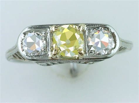 Antique GIA Certified .90ct Fancy Yellow Diamond 18K Gold