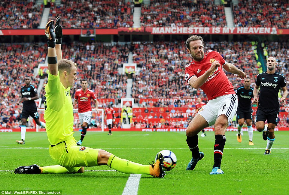 Juan Mata attempts to break the deadlock with a deft effort but sees his effort saved by a sprawling Hart