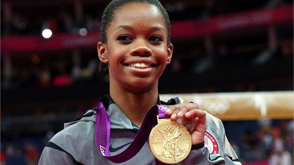 Gabrielle Douglas poses with her gold medal after winning the women's Individual All-Around in gymnastics on August 2, 2012.
