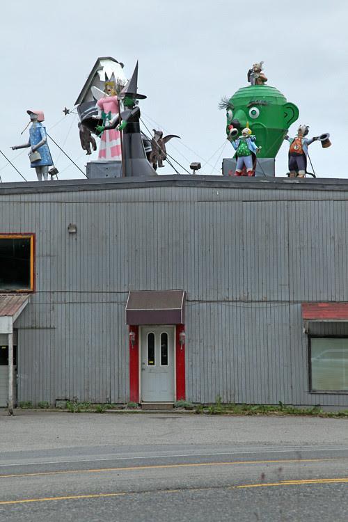 figures on roof of metal company, Juneau, Alaska