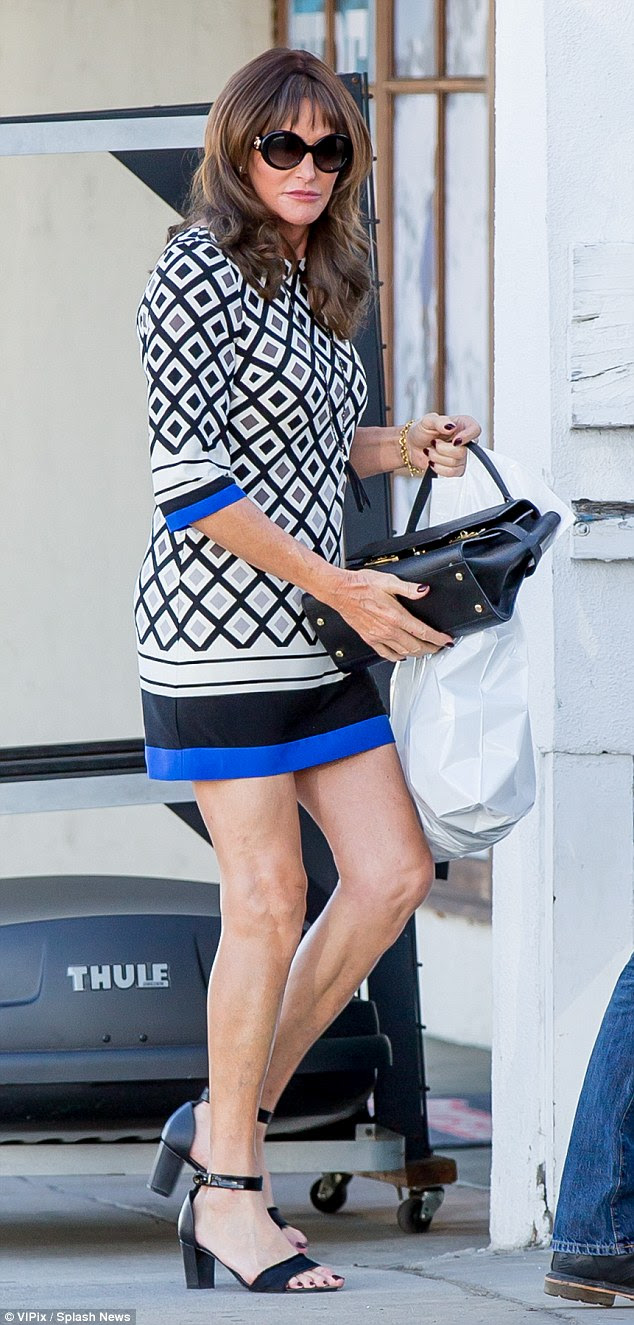 Leggy look: Caitlyn Jenner went bare-legged in a very short mini dress on Monday as she filmed scenes for her E! reality series in Calabasas, California
