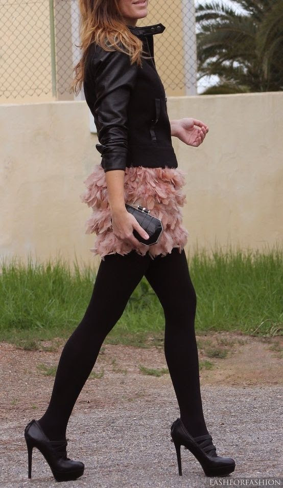 Love the playful ruffle skirt with leather jacket