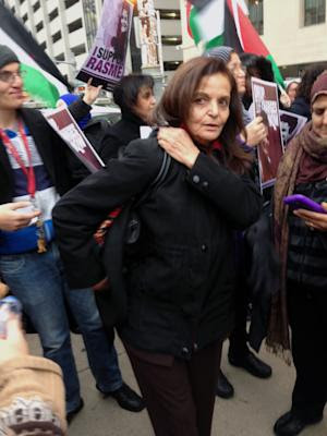 Rasmieh Odeh stands with supporters outside the federal …