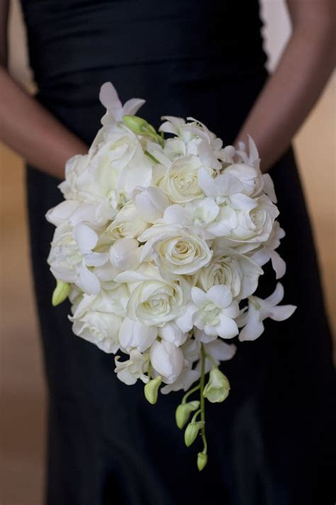 White teardrop bouquet of roses and dendrobium orchids
