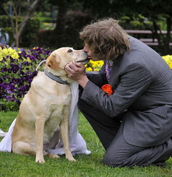 man kissing and marrying his dog