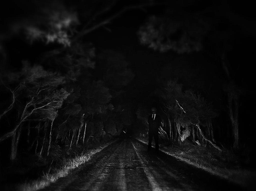 http://littleredplanet.deviantart.com/art/Slender-Man-on-a-Dark-Road-323258134