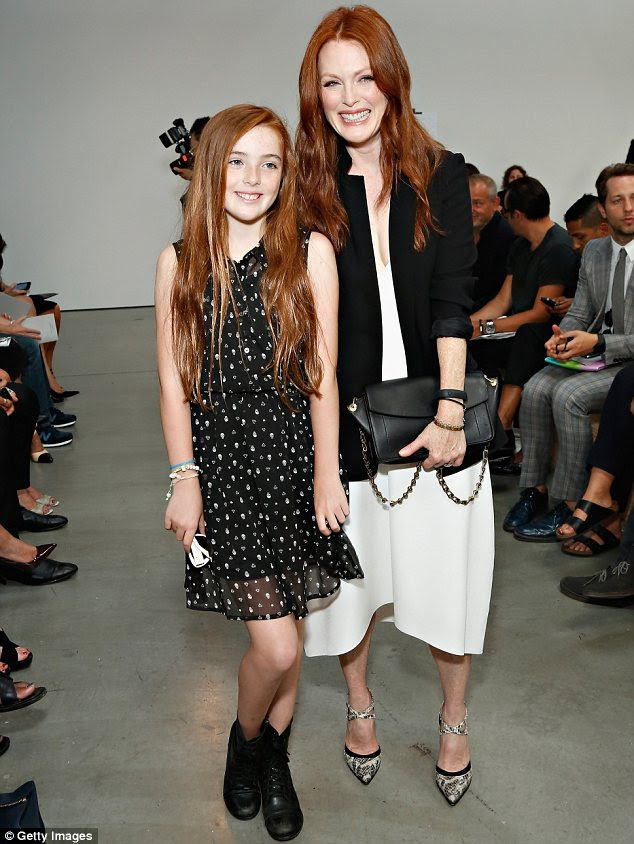 Double act: Julianne Moore brought daughter Liv along to watch the Reed Krakoff show as part of New York Fashion Week on Wednesday