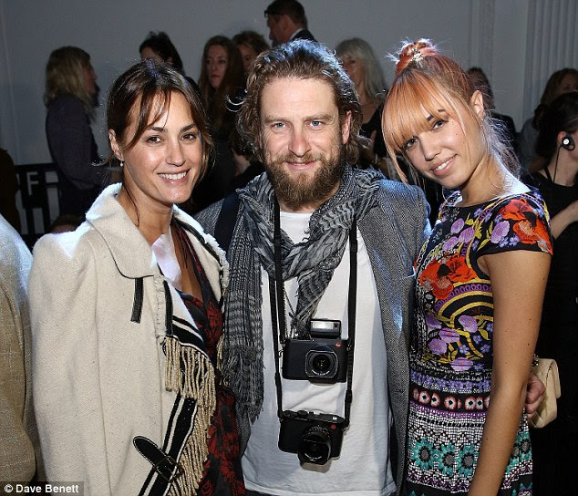 Three's a cool crowd: Yasmin, Gregg Williams and Amber Le Bon all cosied-up for a group shot