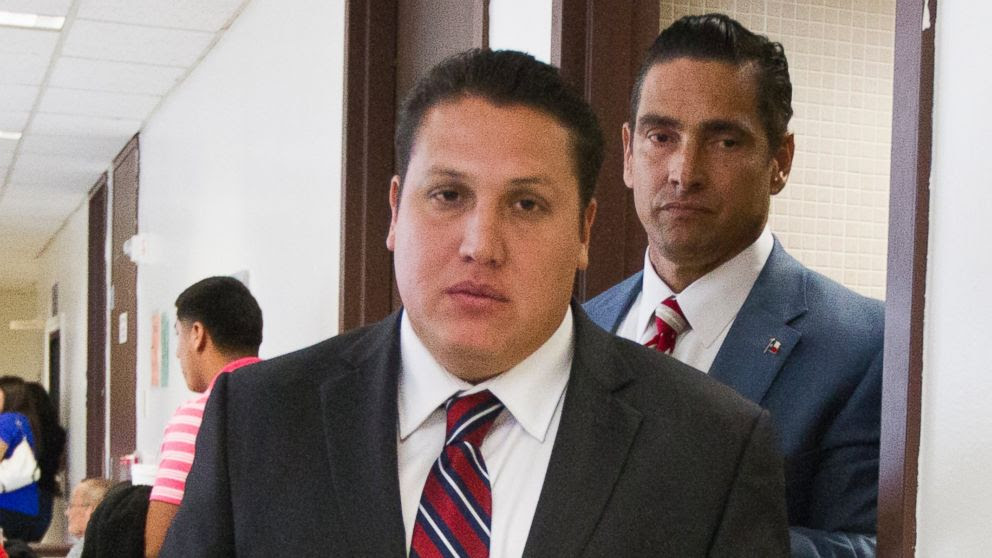 PHOTO: David Barajas, front, walks through the hallway with his lead attorney Sam Cammack at the Brazoria County Courthouse as the jury deliberates on Aug. 27, 2014, Angleton, Texas.
