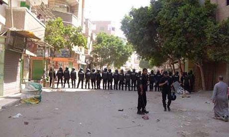 Riot police mobilize to prevent violence at the Saint George's Church in Al-Wasata City of Beni Suef. Sectarian violence escalated in early 2013 in Egypt. by Pan-African News Wire File Photos