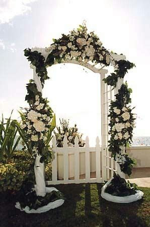Wedding arch with trellis and picket fence   Centerpieces