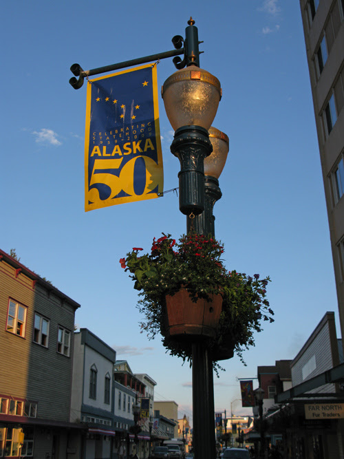 a banner celebrating Alaska's 50th Anniversary as a US state, South Franklin Street, Juneau