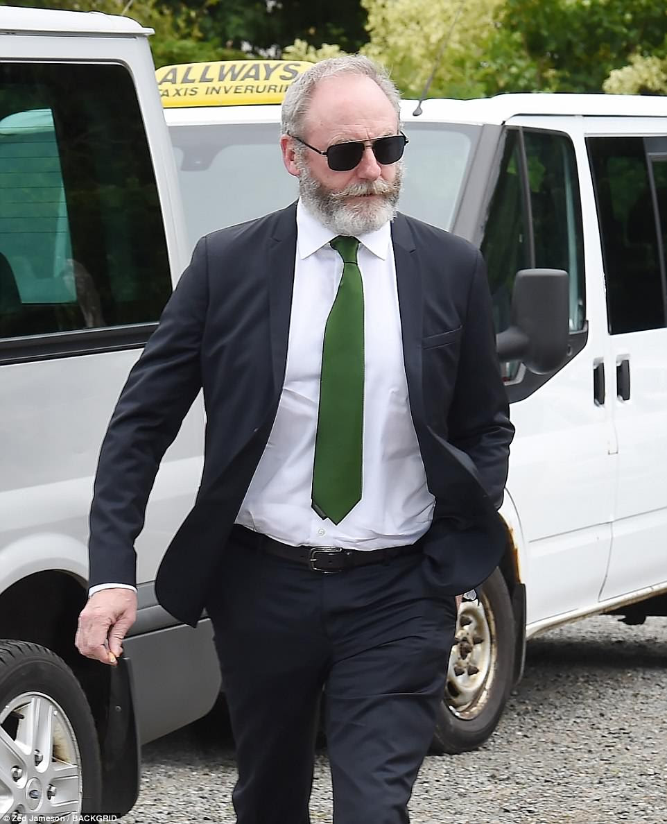 Dapper: Liam Cunningham, who plays Davos Seaworth in GoT, looked handsome in a black suit with a dark green tie, crisp white shirt and black sunglasses