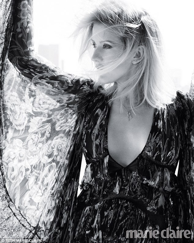 Ethereal: Ellie Goulding dazzles in the magazine for a black and white photo while wearing a low-cut dress