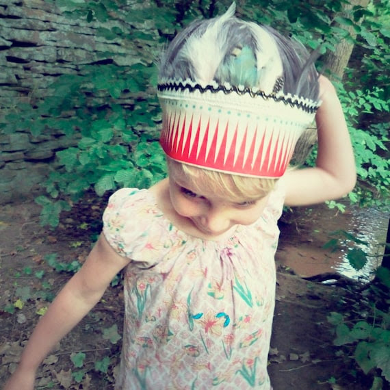 Feather headdress with red triangles and teal dots