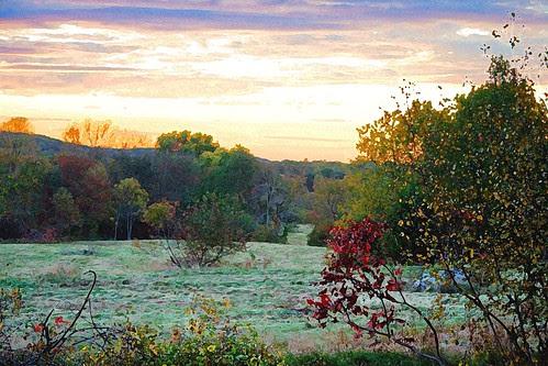 sunset over mowed field - interpretation