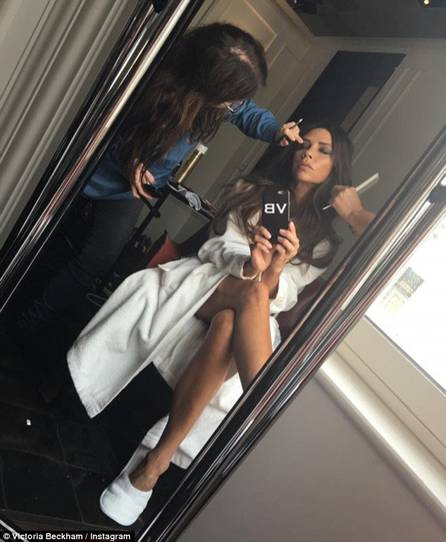 Dress down Fridays: Victoria Beckham ensured her 10.2 million followers would be the first to know about her upcoming shoot as she snapped some pictures of herself  in her dressing gown on Friday