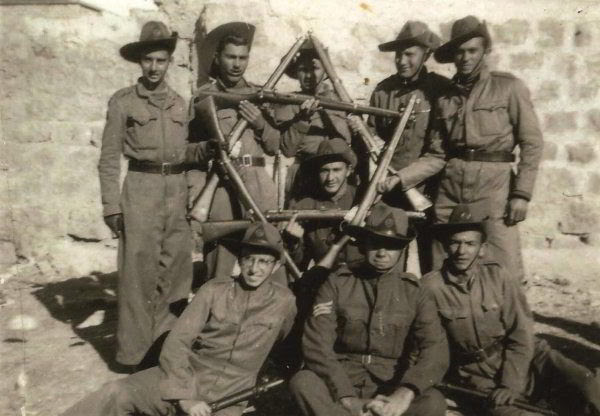 Yehoshua Bar-Hillel, formerly Oscar Westreich (bottom left), with his company in North Africa. They wear the Buffs' Australian slouch hats and defiantly form a Star of David with their rifles