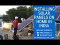 Installing solar panels on home in India