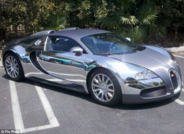 Take one: Flo Rida originally had his white vehicle wrapped in chrome and then decided to go all out with gold