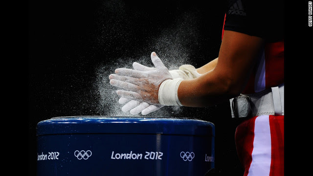 Silvana Saldarriaga of Peru chalks her hands before the women's 63-kilogram weightlifting final.