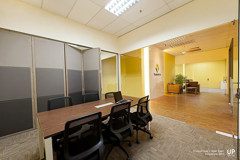 Discussion room with entrance signage, waiting area and conference room at the far end