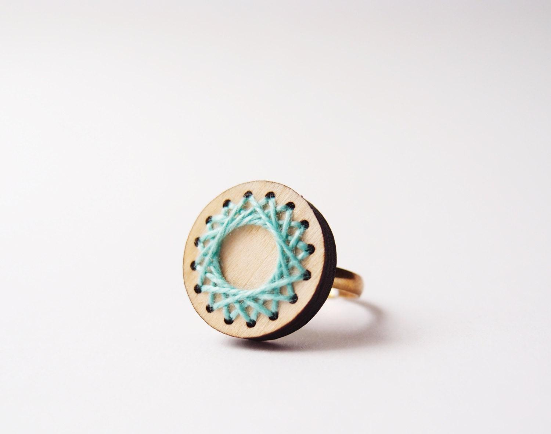 wooden laser cut spirograph ring . mint green thread . geometric circle - TheLittleChilli