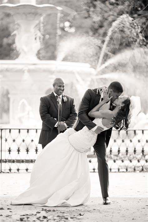 Bride and groom's first kiss at their wedding ceremony at