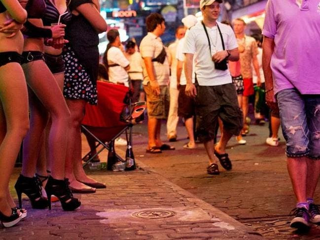 Sex trade ... Young Thai girls stand outside the brothels of Pattaya city. Picture: Getty.