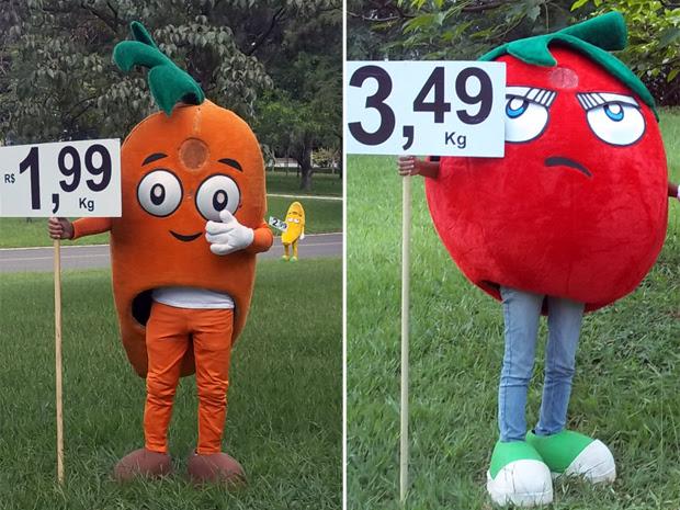 Os 'Sr. Cenoura' e o Sr. Tomate na entrada da quadra comercial 211/212 Sul, em Brasília (Foto: Jamila Tavares / G1)
