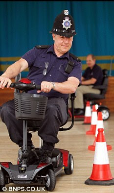 Test drive: PC Dave Williams tries out the mobility scooter course for himself, in a bid to cut accidents in Christchurch, Dorset