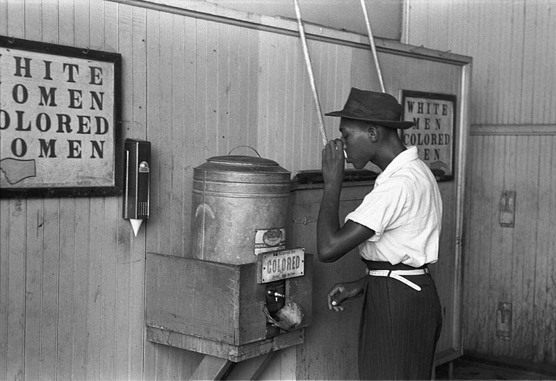 """File:""""Colored"""" drinking fountain from mid-20th century with african-american drinking.jpg"""