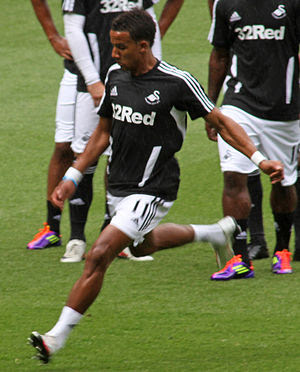 Scott Sinclair of Swansea City warming up for ...
