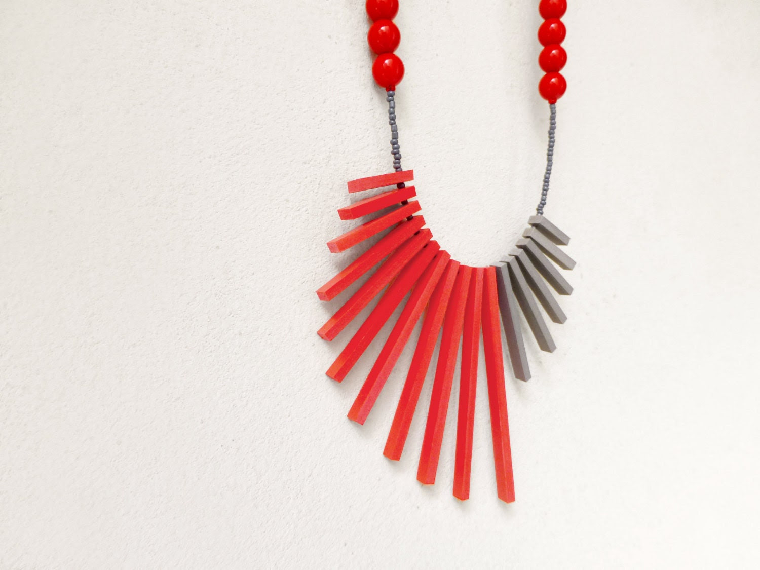 tribal asymmetric minimal necklace with red and grey sticks and beads - contemporary jewelry - pergamondo