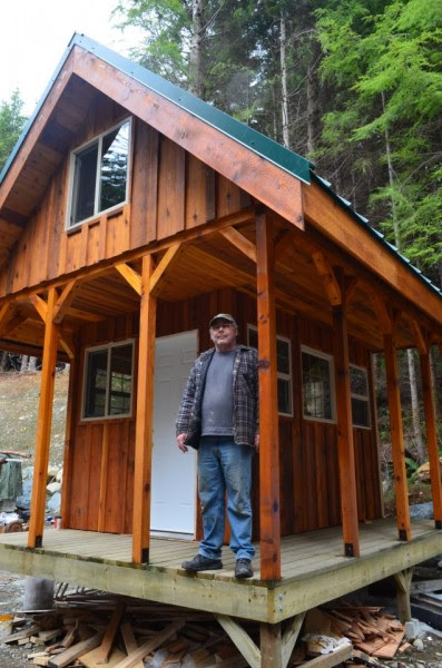Tiny House with a Big Sleeping Loft and Covered Porch Deck