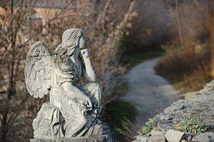 A stone angel at the back of the St. Peter and...