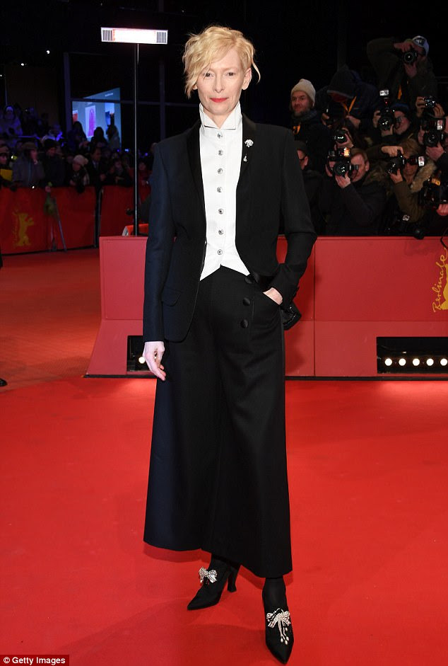 She's out of this world: Tilda Swinton, 57, showed off her trademark androgynous style in a quirky trouser suit and heels as she promoted Isle of Dogs at Berlin film festival on Thursday