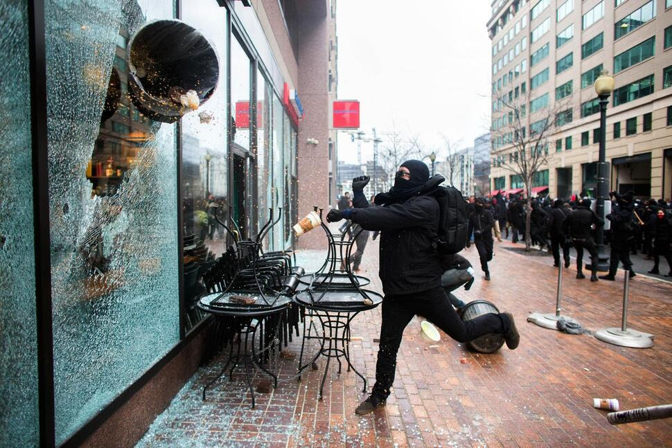 Jan. 20, 2017 | Washington, D.C.: A demonstrator smashes a Starbucks window using a trash can at 12th and I streets.