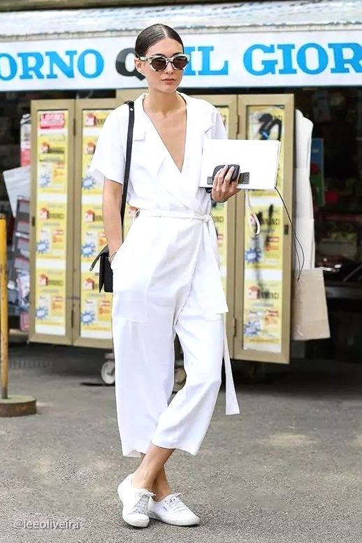 Le Fashion Blog Street Style Low Bun Sunglasses White Jumpsuit Shoulder Bag Sneakers Via Lee Oliveira
